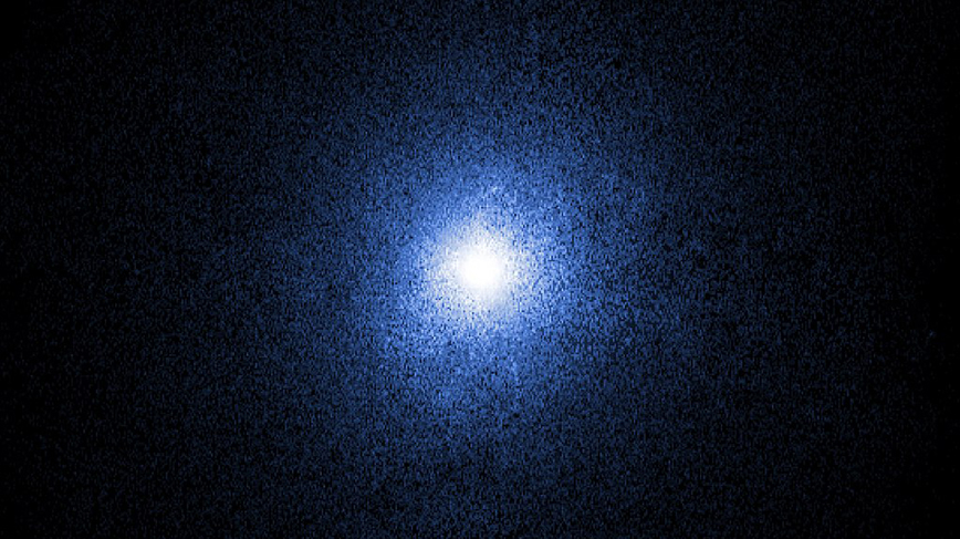 Shining in space, the Cignus X-1 black hole binary appears like a spherical burst of light