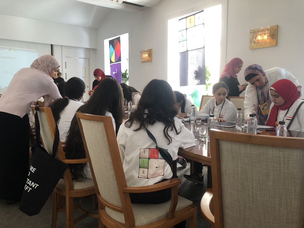 Egyptian girls sitting around a table during workshop