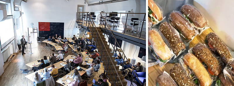 Visual interpretation: Audience and presentation. Also sandwiches on a table.