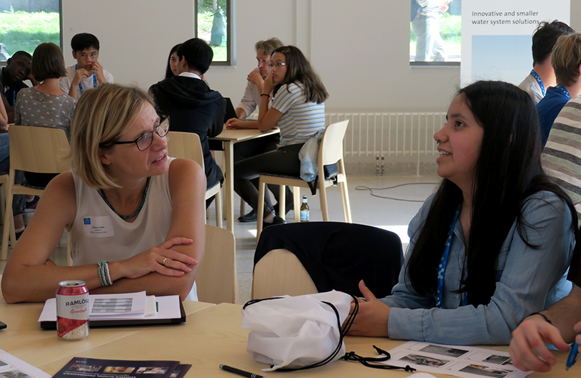 Among the researchers who spent time with the students were, Viktoria Fodor, Communication Networks at the Department for Network and Systems Engineering at the School of Electrical Engineering and Computer Science. Pictured is Professor Fodor speaking with teenage student.