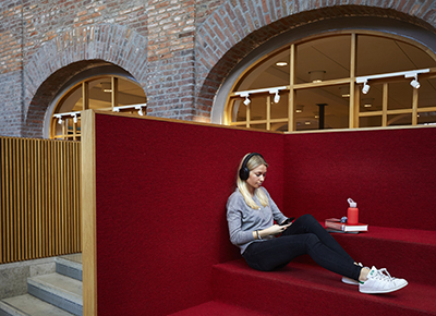 Girl studying at KTH Library while keeping social distancing