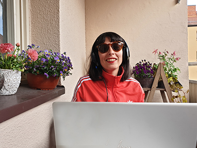 Librarian hold an online tutorial on her balcony