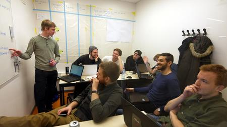 Project meeting with task-board in the background